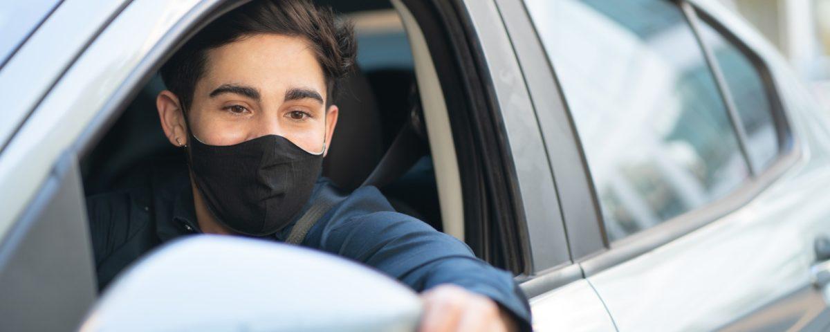 Young man driving his car.